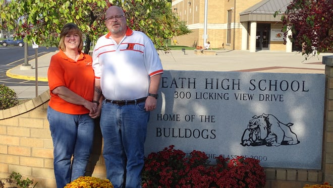 Jean and Mark Wethey have been volunteering for the Heath athletic department for the past 15 years.