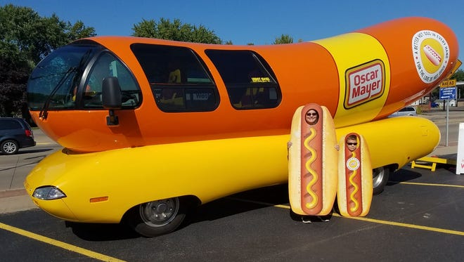 Helen and Thomas Bush pose for a photo with the Wienermobile on Sunday, Sept. 10, 2017, at Quality Foods IGA on West Grand Avenue in Wisconsin Rapids.