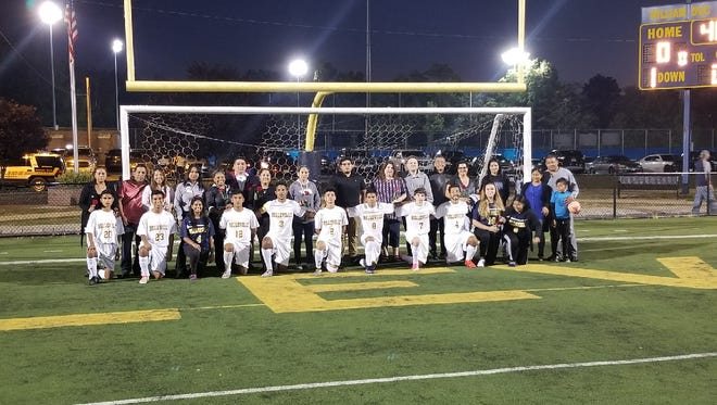 Belleville boys soccer team recognizing its players on Senior Night.