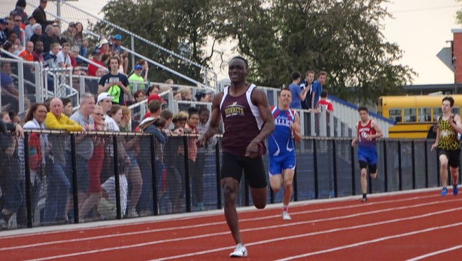 Licking Heights senior Nathaniel Amoah nears the finish line of the 400 this past Friday during the Licking County League-Buckeye Division finals at Lakewood.
