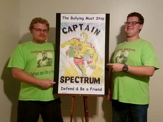 Curtis Miller Jr. and Chris Miller stand next to a