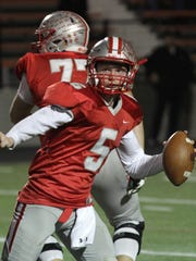 Shelby's Brennan Armstrong looks for an opening during