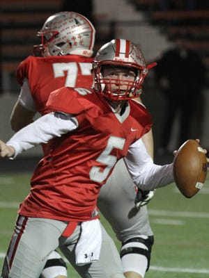 Shelby's Brennan Armstrong looks for an opening during the Whippets' regional championship game against Steubenville on Nov. 18, 2016.