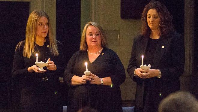 Jessica Dennison, Amanda Lambert, and Stephanie Shelton recite the Nightingale/Nursing Pledge during their pinning ceremony as graduates of Mars Hill University's Judge-McRae School of Nursing, December 15, 2016.