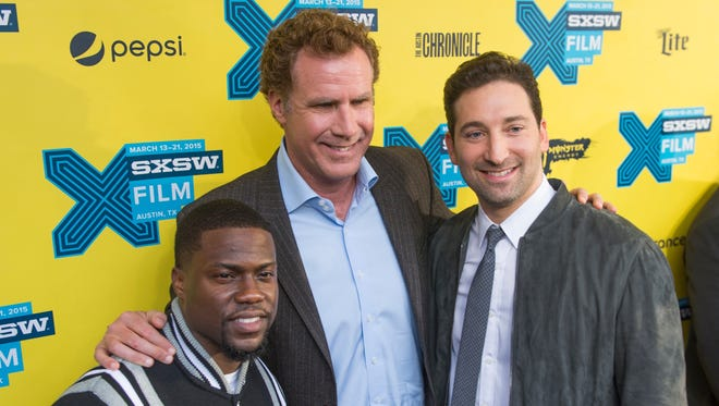 """""""Get Hard"""" stars Kevin Hart and Will Ferrell, with director Etan Cohen, pose for  photographers at South by Southwest on March 16."""