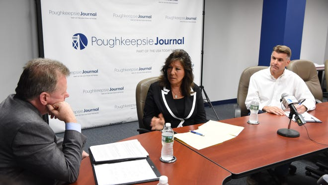 From left, John Penney, Poughkeepsie Journal Opinion and Engagement Editor speaks with New York State Senator Sue Serino and challenger Terry Gipson during Wednesday's Editorial Board meeting.