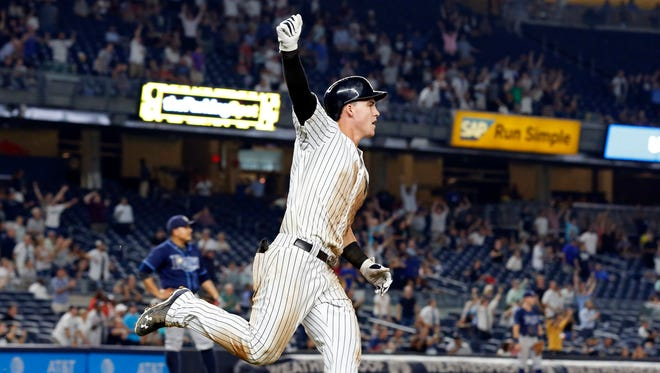New York Yankees' Tyler Austin celebrates his walk-off home run off Tampa Bay Rays relief pitcher Erasmo Ramirez during the ninth inning of a baseball game, Thursday, Sept. 8, 2016, in New York. The Yankees won 5-4.