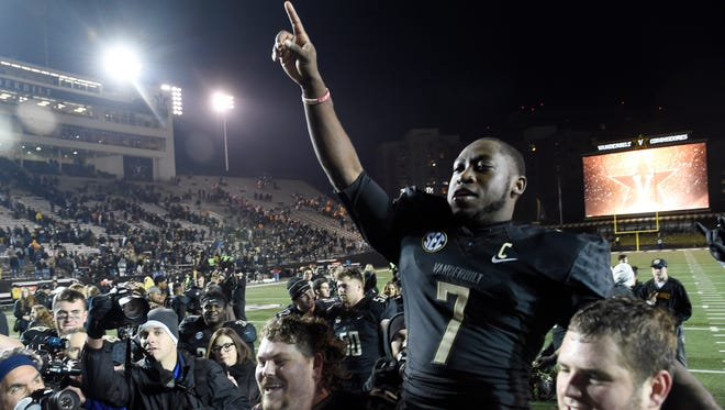 Vanderbilt running back Ralph Webb (7) is carried off the field after the team's win over Tennessee on Nov. 26, 2016, at Vanderbilt Stadium.