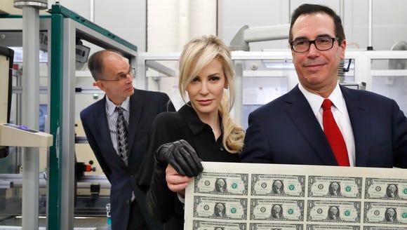 Treasury Secretary Steven Mnuchin, right, and his wife