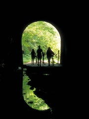 The 32.5-mile Elroy-Sparta State Trail, which has three tunnels that cut through rock, was the nation's first rail-to-trail project.
