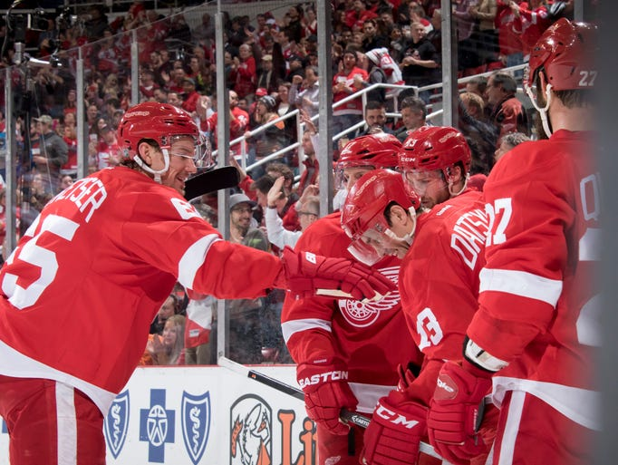 Detroit celebrates a goal by Darren Helm in the first