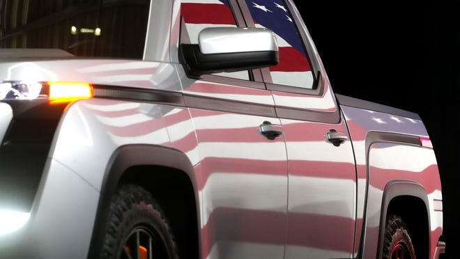 The U.S. flag is reflected from a prototype of Lordstown Motors' new electric pickup Endurance in June.