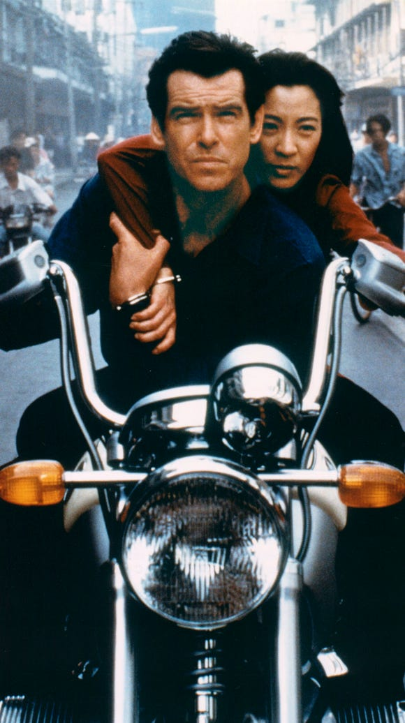 Pierce Brosnan, as Bond, and Michelle Yeoh, as the