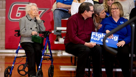 Ruline Steininger of Pleasant Hill, Iowa, left, listens