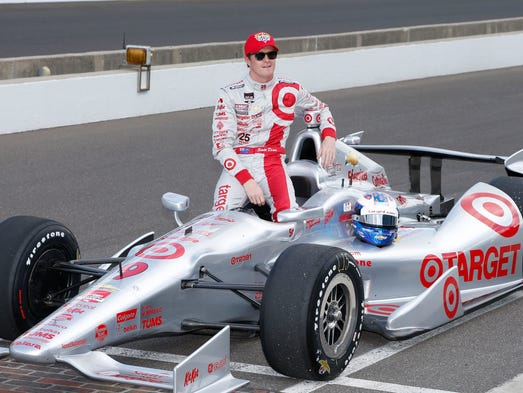 Scott Dixon, born July 22, 1980 and was raised in Auckland, New Zealand, began his U.S. open-wheel racing career in the CART series in  2001 before moving to the IndyCar Series in 2003.