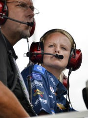 Katelyn Supan, chief engineer for the Chip Ganassi Racing's NASCAR Xfinity Series No. 48 car, looks on from the team pit box during the Xfinity race Saturday, July 22, 2017, afternoon at Indianapolis Motor Speedway.