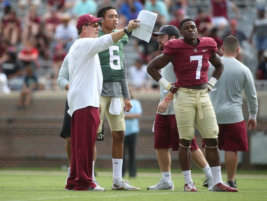 Former FSU head coach Jimbo Fisher works with Malik Henry and Ryan Green during an open practice at Doak Campbell Stadium on Sunday, Aug. 14, 2016.