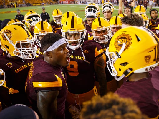 Arizona State running back Kalen Ballage talks with