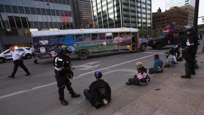"Columbus police detain people who were pulled from the ""Buttercup"" bus in Downtown Columbus. Police said on Facebook that the group was providing tools for rioting to protesters. Those on the bus say they live on the bus, travel as artists and that many of the ""weapons"" are items they use in everyday life or for their shows."