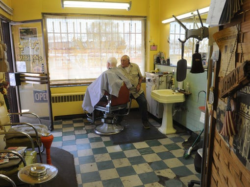 Ikes+CB+Shop Reno barber has cut hair since Ike was president