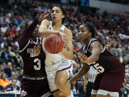 Mississippi State Lady Bulldogs forward Breanna Richardson (3) and center Chinwe Okorie (45) defend against Connecticut Huskies guard Gabby Williams (15) in the second quarter of the 2017 national semifinal against UConn.