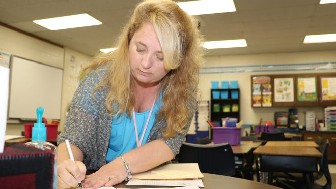 Fourth-grade teacher Lori Clarke prepares for her students at Lonnie B. Nelson Elementary in Richland School District 2 in suburban Columbia, S.C. South Carolina's Career Changers loan-forgiveness program nearly covered the cost of Clarke's master's degree in education from the University of South Carolina.