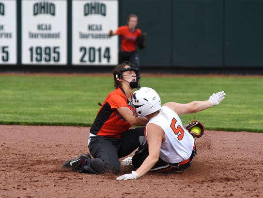 Riley Harris tags out during out Zoiee Smith at second