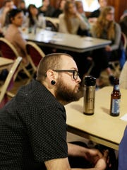Matthew Hinz listens during a proposal at Sheboygan SOUP Thursday April 27, 2017 at Kiwanis Park in Sheboygan, Wis. Hinz gave his own presentation to help improve computer recycling in the city.