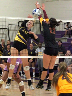 Western's Shannon Rich tallies a kill during action Saturday night at home. She had four kills, one ace and five blocks.