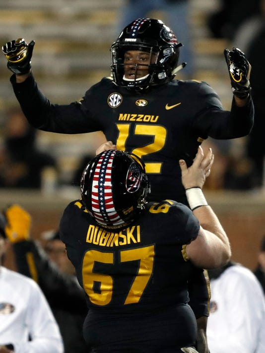 Missouri wide receiver Johnathon Johnson (12) is lifted in celebration by teammate Jonah Dubinski (67) after catching a touchdown pass during the second half of an NCAA college football game against Tennessee, Saturday, Nov. 11, 2017, in Columbia, Mo. (AP Photo/Jeff Roberson)