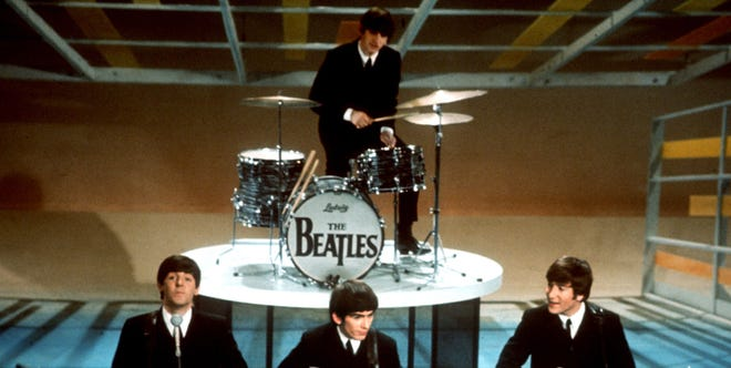 """The Beatles perform on """"The Ed Sullivan Show"""" in New York on Feb. 9."""