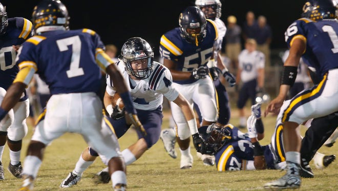 Trevor Begue finds a hole in the Carencro defense to score giving STM a 14-0 after a successful point after on Friday night in the Cro Dome.
