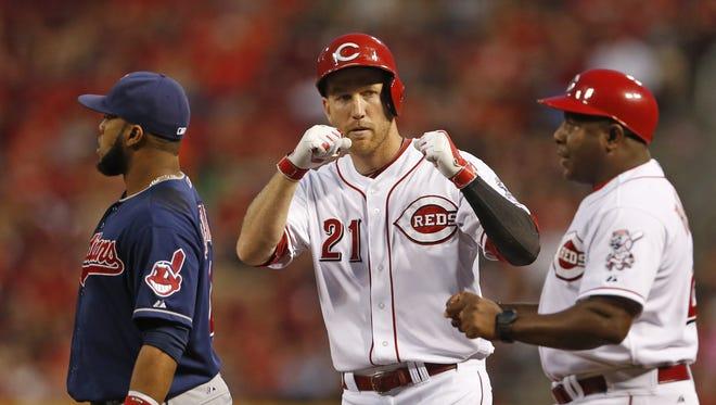 Cincinnati Reds third baseman Todd Frazier (21) singles off Cleveland Indians relief pitcher Nick Hagadone (50) during the sixth inning.