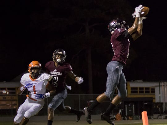 Raiders' Dante Wright (5) intercepts a pass in their