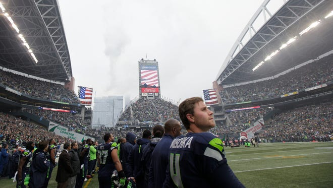 Seattle Seahawks kicker Steven Hauschka (4) stands on the field at CenturyLink Field during the national anthem before an NFL football game between the Seattle Seahawks and the Pittsburgh Steelers, Sunday, Nov. 29, 2015, in Seattle.
