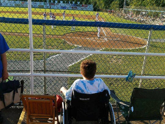 Ellen Grant watches the Staunton Braves, sitting next