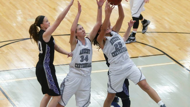Centennial sophomore Keanna Williams goes up for an offensive rebound against Waukee on Friday, Dec. 18, 2015, at Ankeny Centennial High School.