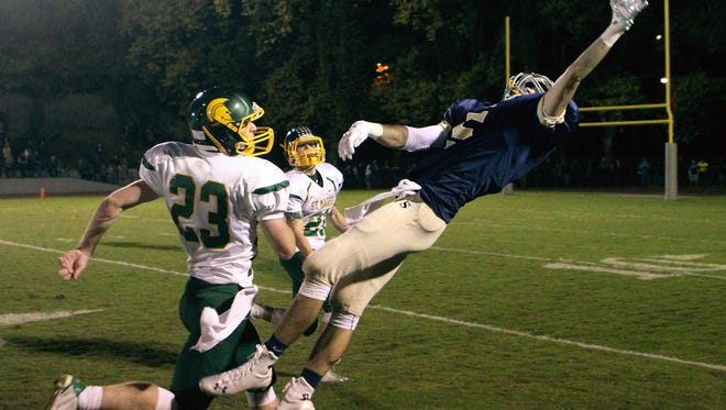 A pass goes off the fingertips of Salesianum's Jeremy Ryan as St. Mark's Greg Betts (left) and Rhett Schweizer defend during last year's 28-21 St. Mark's win at Baynard Stadium.