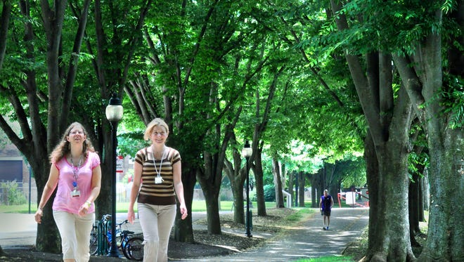The Heritage Rail Trail draws city workers for a lunchtime walk. file photo