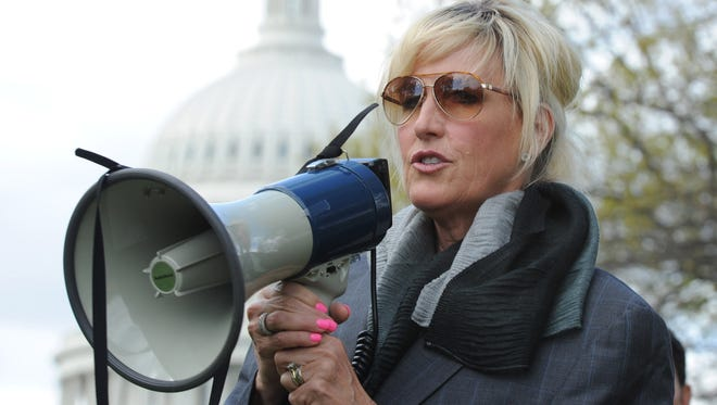 """Environmental activist Erin Brockovich addresses a news conference near the U.S. Capitol in Washington on April 23, 2014. She and others protested the U.S. Department of Justice's position in a landmark Supreme Court case, CTS Corporation v. Waldburger. Brockovich recently appeared on HBO's """"Real Time With Bill Maher"""" to speak about problems with municipal water systems."""