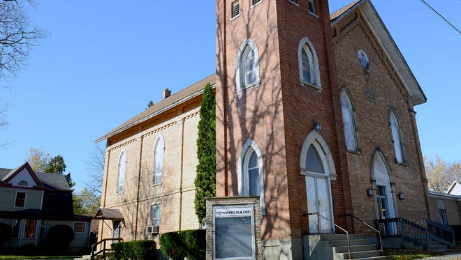 The 137-year-old church on Scott Street, pictured Monday, Nov. 7, 2016 in Grand Ledge, could soon house visitors. Ann Duchene bought the old church with plans to turn it into an inn. Phase 1 of that construction would begin with four rooms on the first floor of the building. Later phases of the construction would include remodeling the sanctuary space into two floors of additional rooms. The office space of the church would be leased out to local businesses.