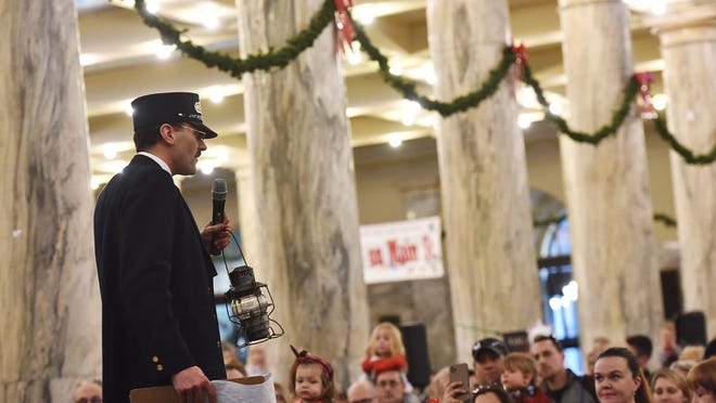 In this December 2019 file photo, the conductor from the Polar Express train with the Adirondack Scenic Railroad speaks to passengers at Utica's Union Station. The event has been postponed for 2020 due to the coronavirus pandemic.