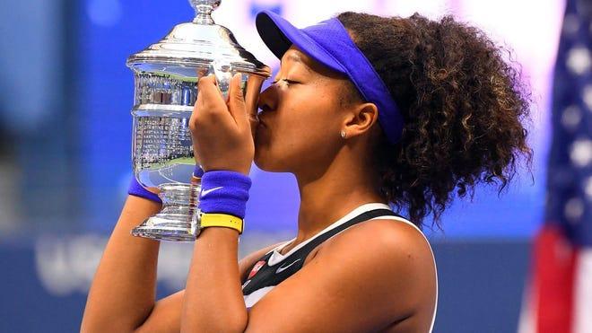 Naomi Osaka of Japan celebrates winning against Victoria Azarenka of Belarus in the US Open women's final.