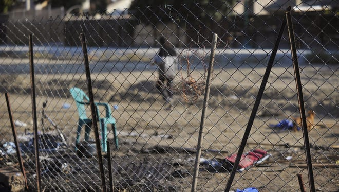 The Jaramillo family has noticed an increase in homeless activity directly behind the home on North Bridge Street.