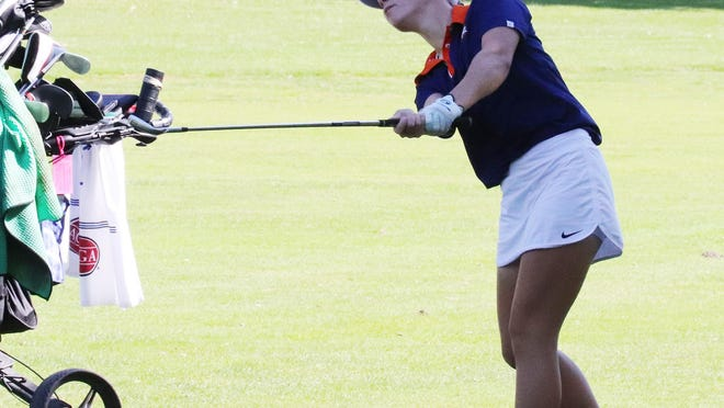 Dani Grace Schrock watches her approach shot on No. 12 fly toward the green. The ball found its mark and Schrock made the birdie putt on her way to a 76 in regional play at the Elks Club Golf Course Wednesday.