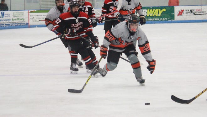 Vinny Tomasetti (20) of Middletown North led the Lions to a 3-1 win over Jackson with his 100th point on Friday.