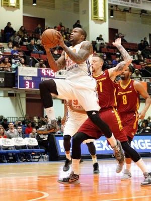 Westchester Knicks Ra'Shad James (90) drives to the basket against the Canton Charge at the Westchester County Center in White Plains on Thursday, March 03, 2016.  James is a 2008 White Plains Hgh School graduate.
