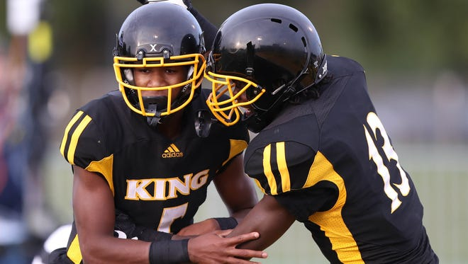 Detroit King's Dequan  Finn celebrates his touchdown with Rashawn Williams during the first half of King's win over Indianapolis Cathedral, 38-35, on Saturday, Aug. 26, 2017, at Wayne State.