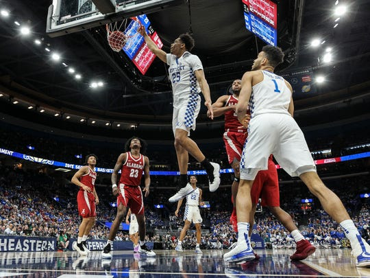 Kentucky's PJ Washington slams down two in the first half against Alabama during Saturday's semifinal SEC Tournament game in St. Louis. March 10, 2018