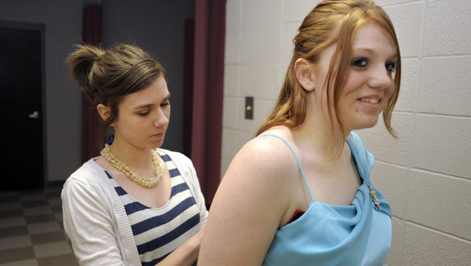 Alana Mink gets a little help from Julie Vornholt as she tries on prom dresses. The Danville Rotary Club sponsored Project Princess, offering donated prom dresses to high school students on a slim budget.
